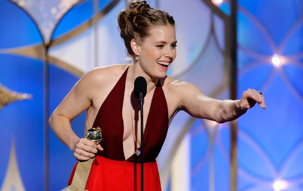 Amy Adams accepting the award for best actress in a motion picture, musical or comedy for her role in, `American Hustle` during the 71st annual Golden Globe Awards.