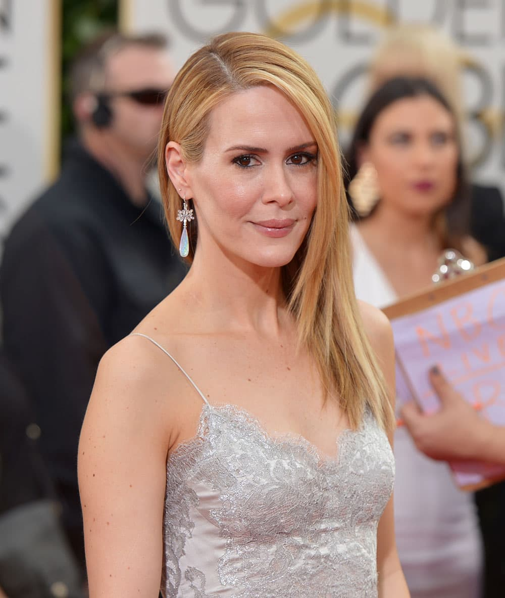Sarah Paulson arrives at the 71st annual Golden Globe Awards at the Beverly Hilton Hotel.