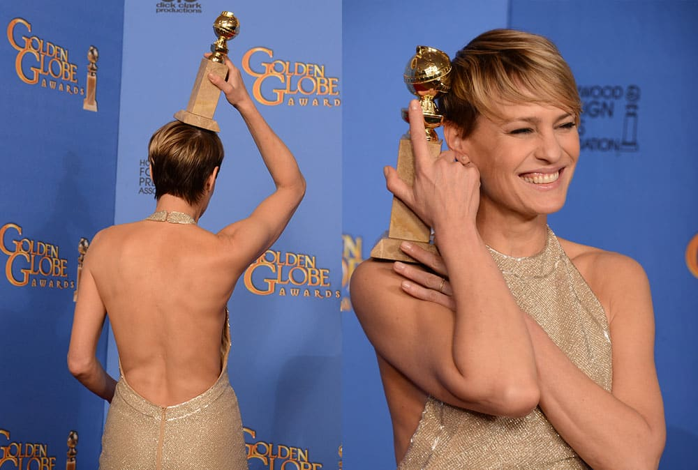 Robin Wright poses in the press room with the award for best actress in a television series - drama for `House of Cards` at the 71st annual Golden Globe Awards.