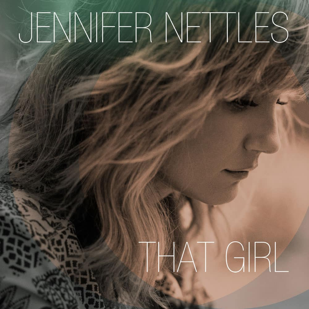 This CD cover image released by Universal Nashville shows `That Girl,` by Jennifer Nettles. Nettles made her career singing with others as a part of the Grammy-winning band Sugarland and performing well-known duets with artists like Bon Jovi, James Taylor and many more.