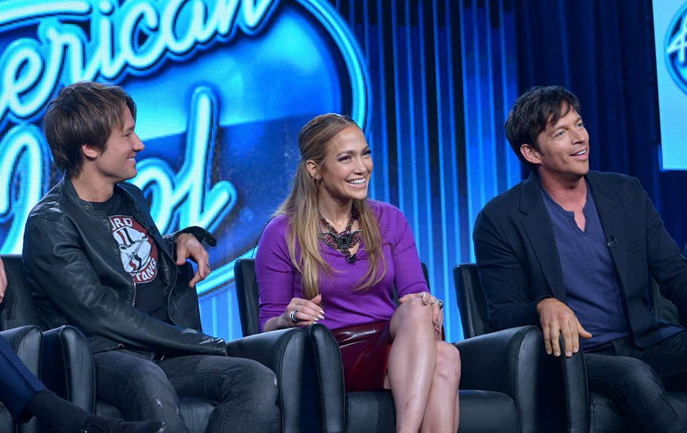 Judges, from left, Keith Urban, Jennifer Lopez, and Harry Connick Jr. are seen during the panel of `American Idol` at the FOX Winter 2014 TCA, at the Langham Hotel in Pasadena, Calif.