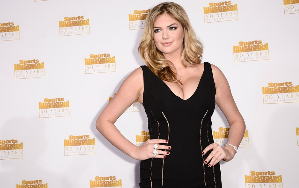Model Kate Upton arrives at the '50 Years of Beautiful' television event celebrating the Sports Illustrated Swimsuit Issue's 50th Anniversary at the Dolby Theatre, in Los Angeles.
