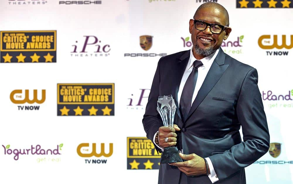 Forest Whitaker poses with the Joel Siegel Award in the press room at the 19th annual Critics' Choice Movie Awards at the Barker Hangar, in Santa Monica, Calif.