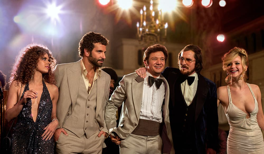 This film image released by Sony Pictures shows, Amy Adams, Bradley Cooper, Jeremy Renner, Christian Bale and Jennifer Lawrence in a scene from 'American Hustle.'