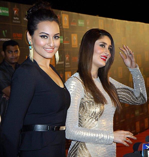 Sonakshi Sinha and Kareena Kapoor during an Awards show in Mumbai.
