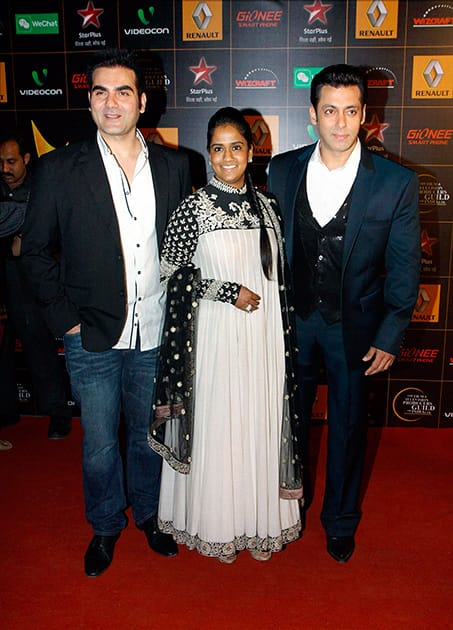 Salman Khan and Arbaaz Khan with their sister Arpita Khan during an Award show in Mumbai.