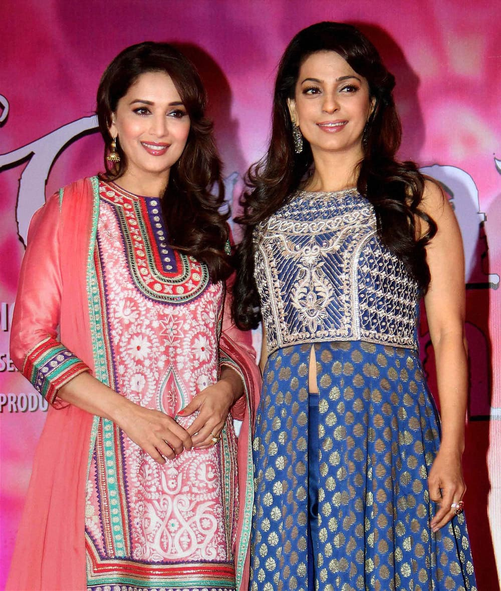 Bollywood actress Madhuri Dixit with Juhi Chawla during a promotional event of her upcoming movie Gulaab Gang in Mumbai.