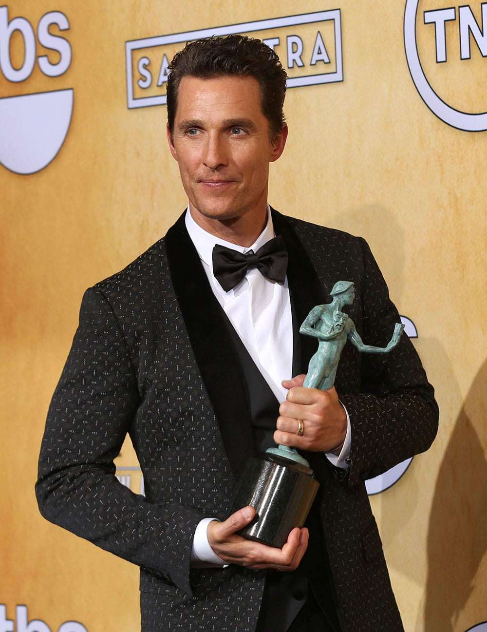 Matthew McConaughey poses in the press room with the award for outstanding performance by a male actor in a leading role for `Dallas Buyers` at the 20th annual Screen Actors Guild Awards at the Shrine Auditorium.