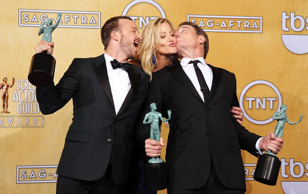 From left, Aaron Paul, Anna Gunn and Bryan Cranston pose in the press room with their awards for outstanding performance by an ensemble in a drama series for `Breaking Bad` at the 20th annual Screen Actors Guild Awards at the Shrine Auditorium.