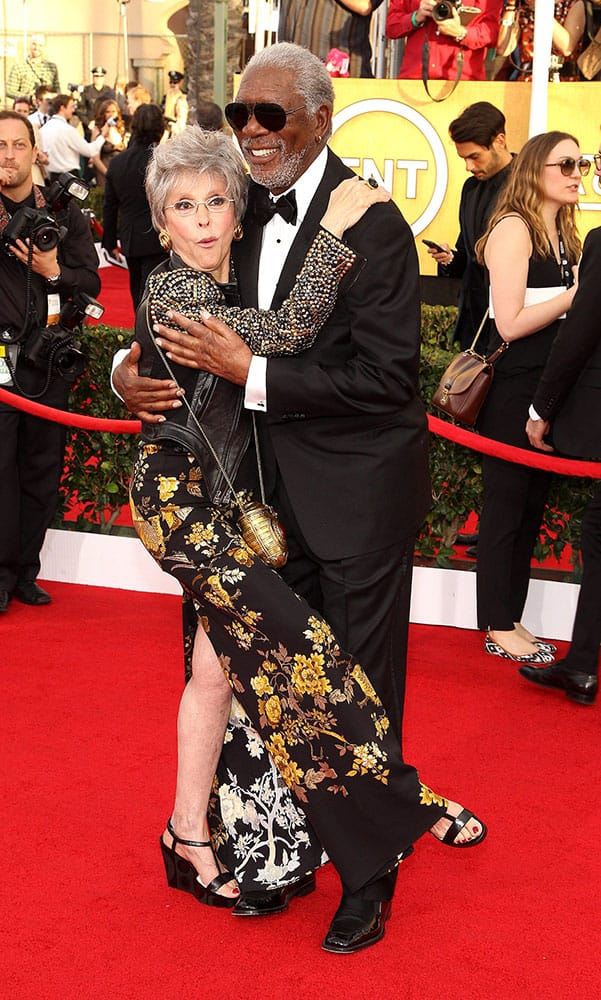 Rita Moreno and Morgan Freeman arrive at the 20th annual Screen Actors Guild Awards at the Shrine Auditorium.