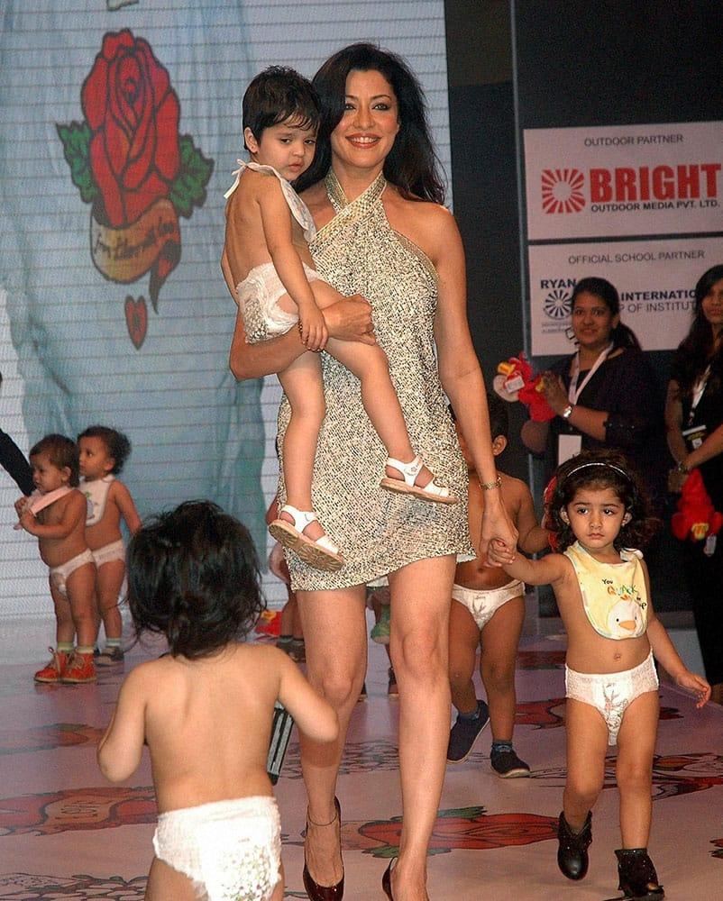 Model Aditi Gowitrikar with kids duirng the India Kids Fashion Week in Mumbai.