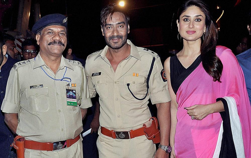 Kareena Kapoor, Ajay Devgan with Inspector Vasant Dhoble, during the annual Mumbai Police event, Umang 2014, in Mumbai.