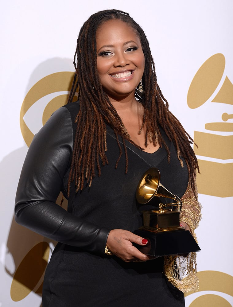 Lalah Hathaway poses in the press room with the award for best R&B performance for `Something` at the 56th annual GRAMMY Awards at Staples Center in Los Angeles.