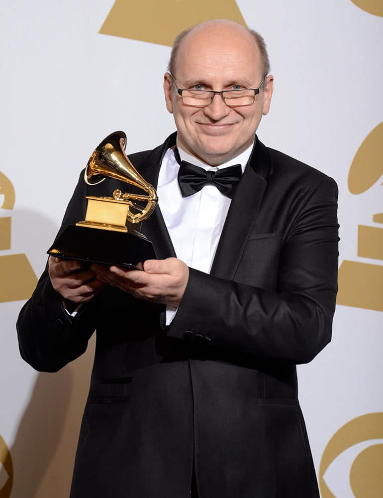 Wlodzimierz Pawlik poses in the press room with the award for best large jazz ensemble album for `Night In Calisia` at the 56th annual Grammy Awards.