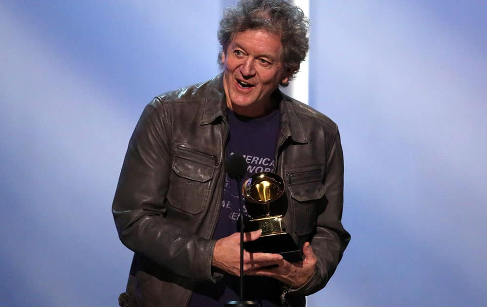 Rodney Crowell poses accepts the award for best Americana album for `Old Yellow Moon` at the pre-telecast of the 56th annual Grammy Awards.