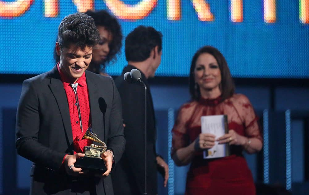 Bruno Mars accepts the award for best pop vocal album for `Unorthodox Jukebox` at the 56th annual Grammy Awards.