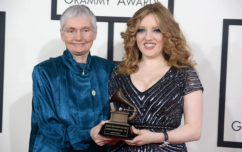 Karen A. Shaffer and Rachel Barton Pine with the Lifetime Achievement Grammy on behalf of Maud Powell arrive at the 56th annual Grammy Awards.