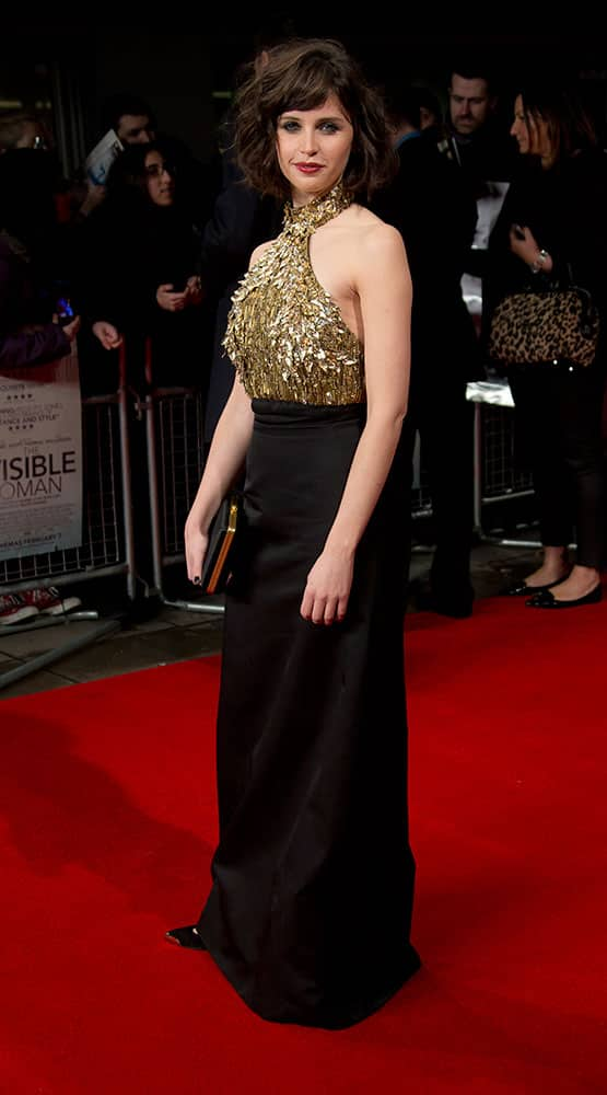 British actress Felicity Jones arrives on the red carpet for the British Premiere of `The Invisible Woman` at a cinema in west London.