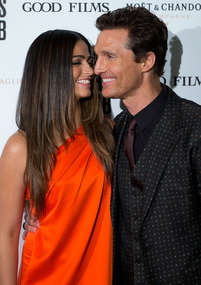 Actor Matthew McConaughey flanked by his wife Camila Alves, poses for photographer as he arrives at the screening of his movie `Dallas Buyers Club` in Rome.