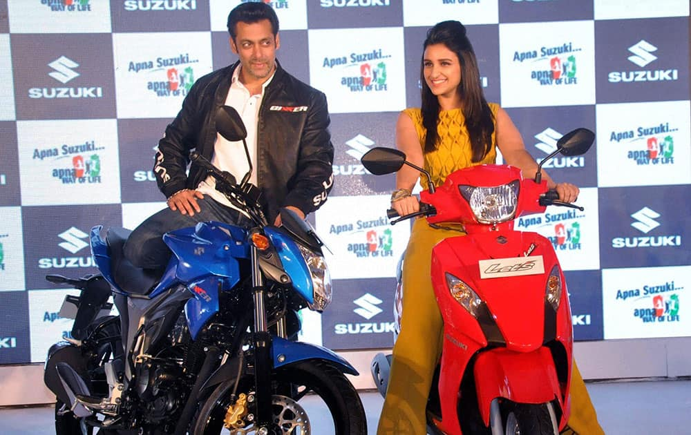 Bollywood Actors Salman Khan and Parineeti Chopra during the launch of Two New Suzuki Wheelers 'Gixxer' and 'Let's' Motorcyclesin Mumbai.