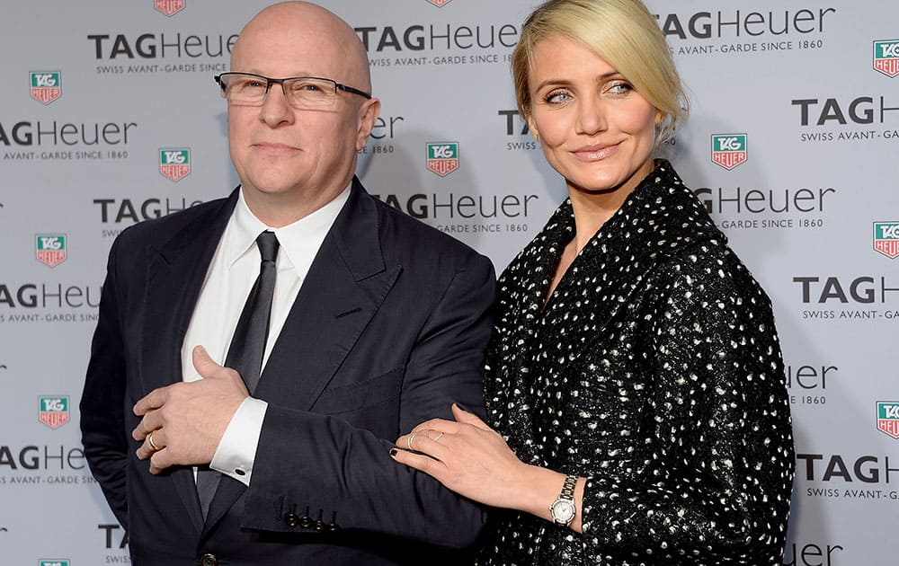 Tag Heuer CEO, Stephane Linder and actress Cameron Diaz pose together at the Tag Heuer flagship store opening in New York.