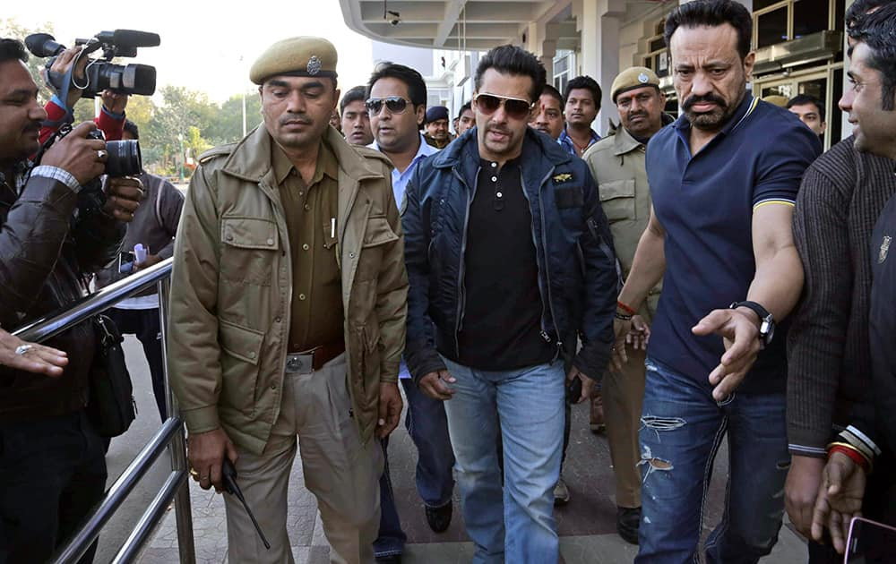 Salman Khan is escorted by policemen to a court in Jodhpur. Khan is in Jodhpur in connection with a rare buck poaching case in a desert wildlife preserve in 1998. After recording his statements, the court deferred the matter to March 10.
