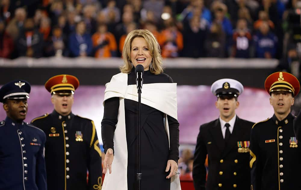 Opera singer Renée Fleming sings the national anthem before the NFL Super Bowl XLVIII football game between the Seattle Seahawks and the Denver Broncos in East Rutherford, N.J.