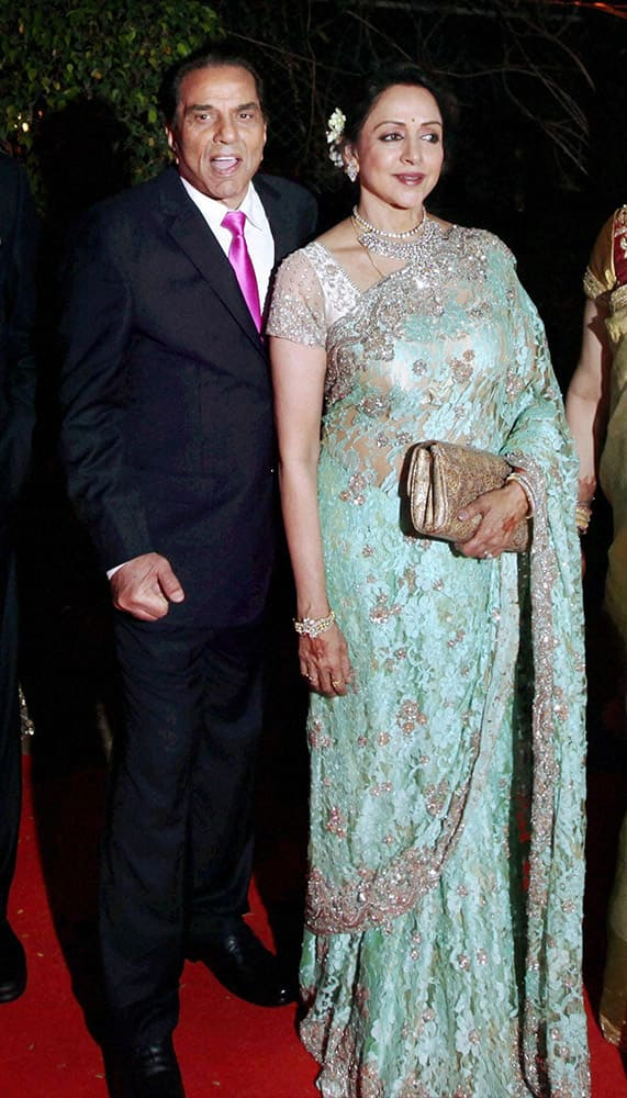 Bollywood actors Hema Malini and Dharmendra at their younger daughter Ahana Deol and Vaibhav Vora's wedding ceremony in Mumbai.