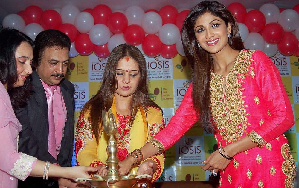 Actress Shilpa Shetty lighting lamp at a programme in Varaansi.