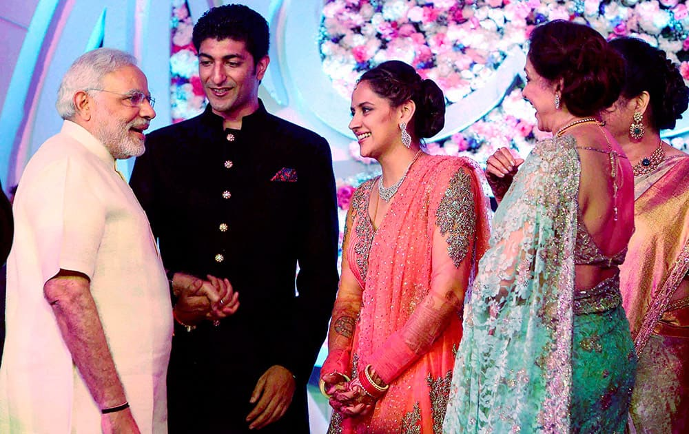 Gujarat Chief Minister Narendra Modi with Bollywood Actor Hema Malini and Dharmendra's younger daughter Ahana Deol and Vaibhav Vora during their wedding reception in Mumbai.
