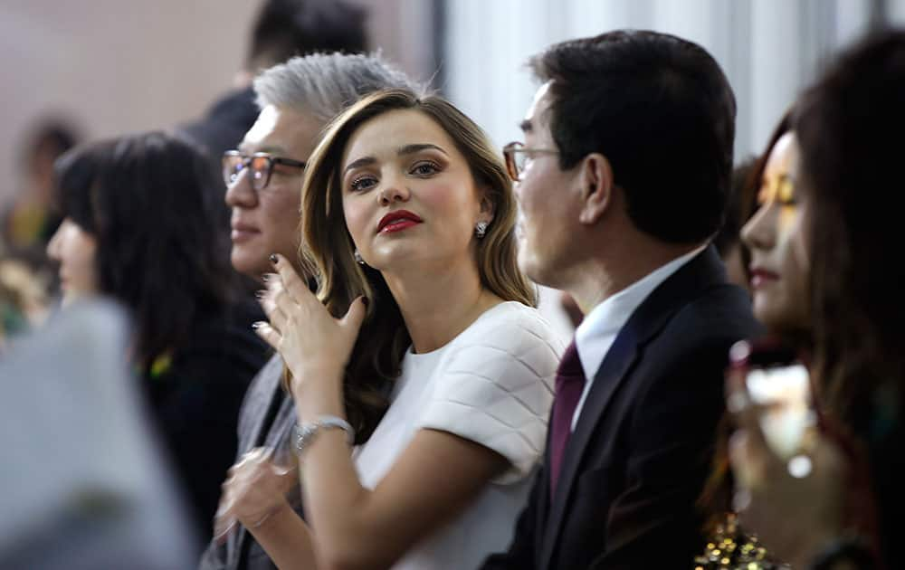 Supermodel Miranda Kerr adjusts her hair during the presentation of the GS Shop Lingerie show featuring Spanx, Wonderbra, Platex and Anna Sui during Fashion Week in New York.