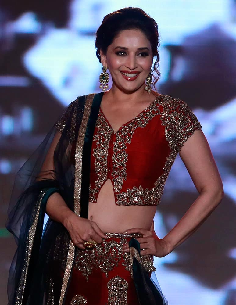 Bollywood actress Madhuri Dixit displays an outfit by Indian designer Manish Malhotra during a fashion show to support the cause of saving and empowering the female child in Mumbai.