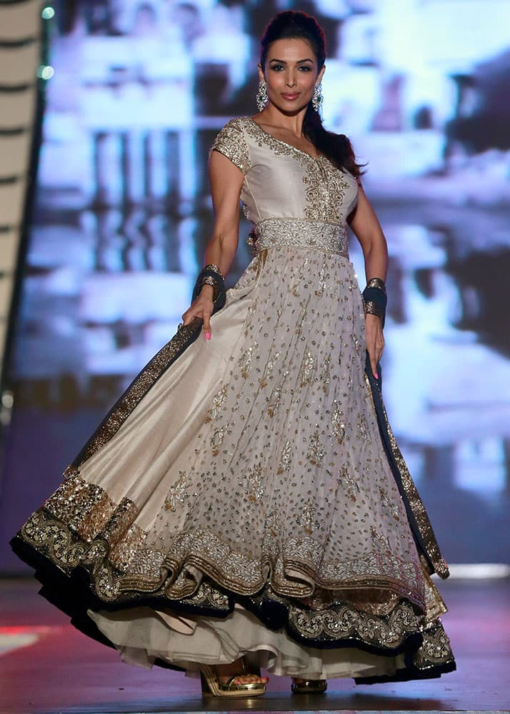 Actress Malaika Arora displays an outfit by Indian designer Manish Malhotra during a fashion show to support the cause of saving and empowering the female child in Mumbai.