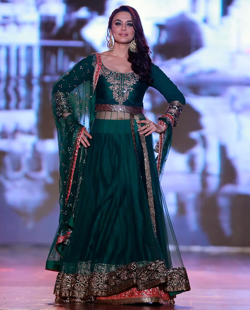 Bollywood actress Prety Zinta displays an outfit by Indian designer Manish Malhotra during a fashion show to support the cause of saving and empowering the female child in Mumbai.
