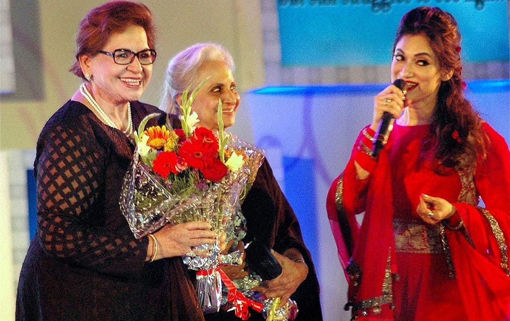 Veteran actresses Waheeda Rehman, Helen with actress Lucky Morani during a Manish Malhotra fashion show as part of 'Save & Empower the Girl Child' initiative in Mumbai.