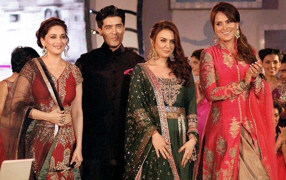 Bollywood actresses Madhuri Dixit Nene, Preity Zinta and Lara Dutta pose with fashion designer Manish Malhotra on the ramp for 'Save & Empower the Girl Child' initiative by Lilavati hospital in Mumbai.
