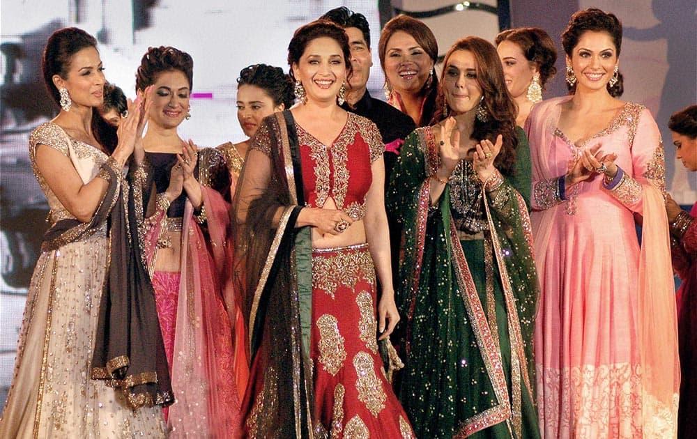 Bollywood actresses Madhuri Dixit Nene, Preity Zinta, Lara Dutta, Malaika Arora Khan and Isha Koppikar pose on the ramp for 'Save & Empower the Girl Child' initiative by Lilavati hospital in Mumbai.
