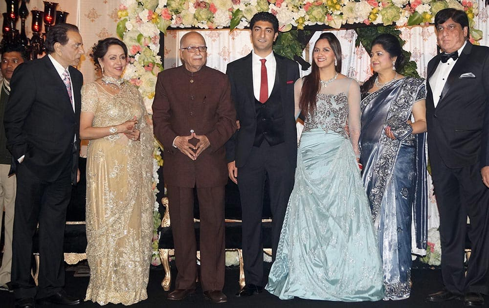 Senior BJP leader LK Advani, actor Dharmendra, actress Hema Malini with Ahana Deol and Vaibhav at their wedding reception in New Delhi.
