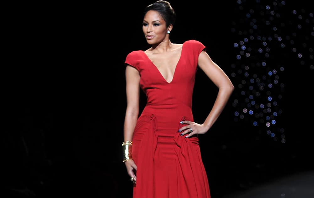 TV personality Alicia Quarles models an outfit from the 2014 Red Dress Collection in New York.
