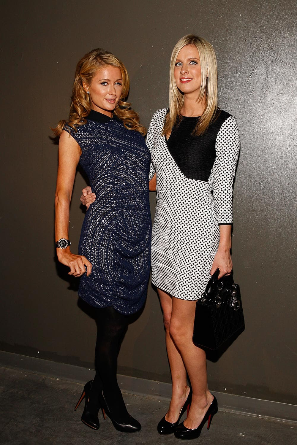 Paris Hilton and Nicky Hilton attend MBFW 2014 Fall/Winter Charlotte Ronson presentation, in New York.