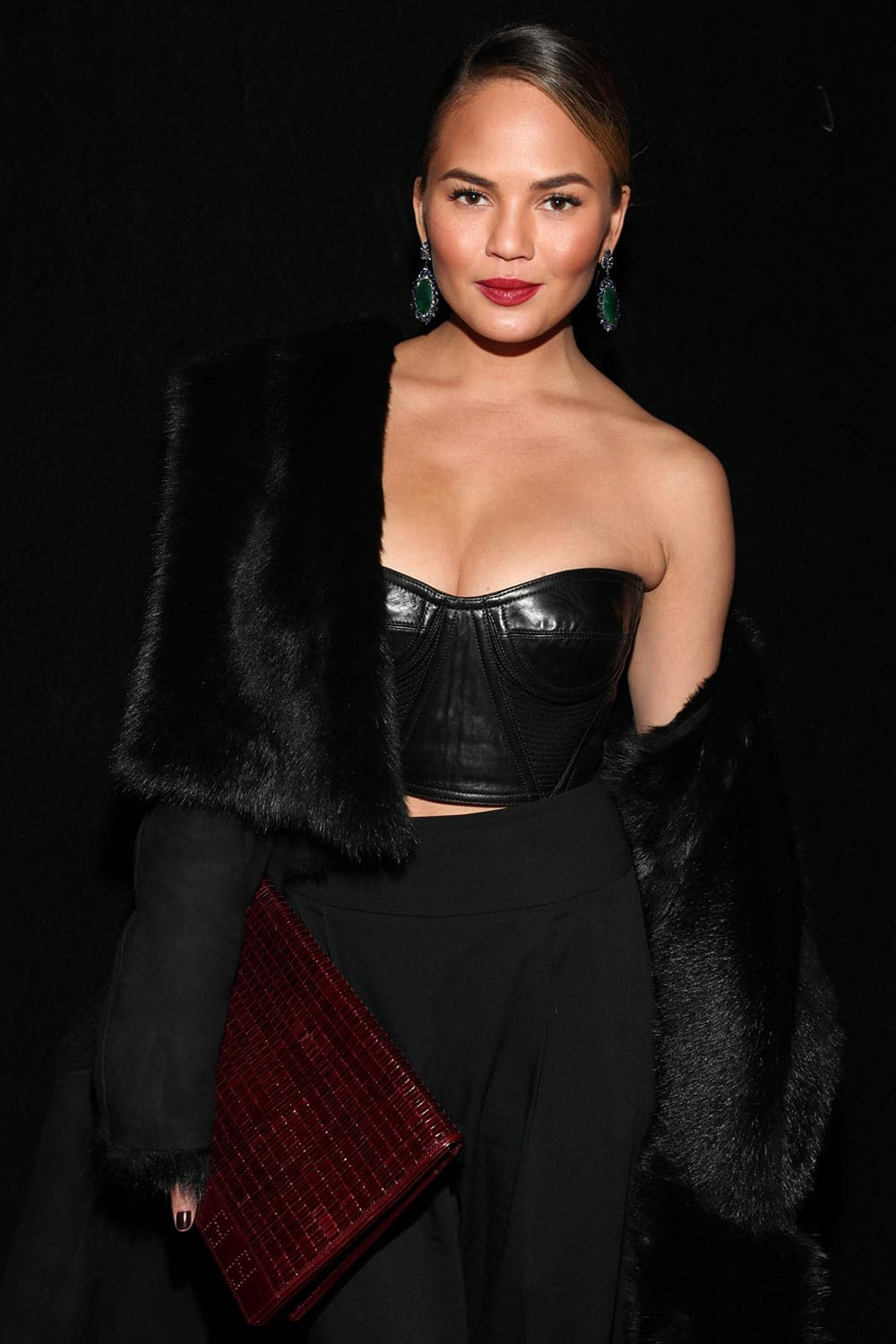 Model Chrissy Teigen attends the DKNY 30th Anniversary fashion show during Mercedes-Benz Fashion Week.