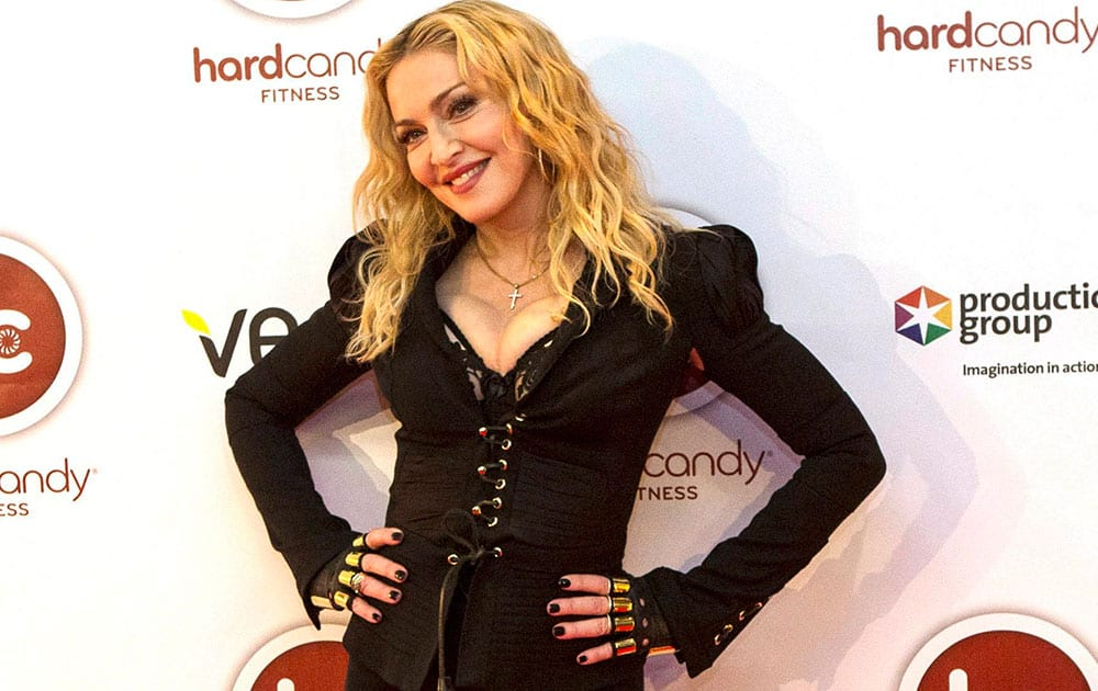 Madonna arrives at the opening of Toronto's Hard Candy Fitness.