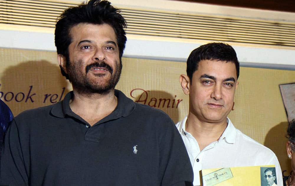 Bollywood actors Anil Kapoor and Aamir Khan at the launch of a book 'Sagar Movie Tone' in Mumbai.