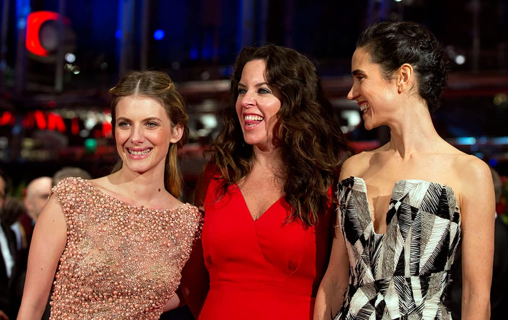 Actress Melanie Laurent, director Claudia Llosa and actress Jennifer Connelly pose for photographers on the red carpet for the film Aloft during the International Film Festival.