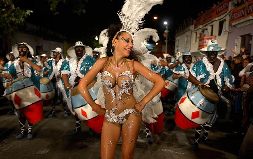 A dancer performs in Las Llamadas or Calls parade during Carnival celebrations in Montevideo, Uruguay.
