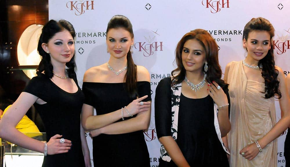 Bollywood actress Humaa Qureshi poses with models during a promotional event at a jewellery showroom in Amritsar.