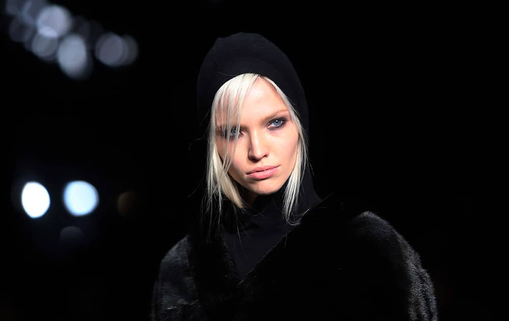 A model wears a design created by Tom Ford during London Fashion Week Autumn/Winter 2014.