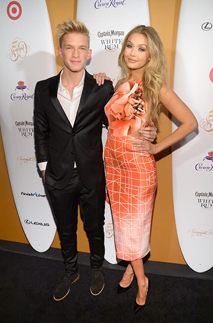 Australian singer Cody Simpson and girlfriend model Gigi Hadid attends the 2014 Sports Illustrated Swimsuit 50th Anniversary Issue kickoff event at Swimsuit Beach House in New York.