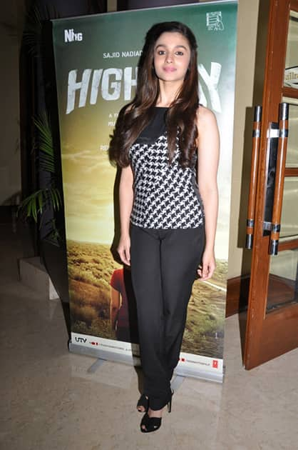 Alia with Imtiaz Ali for the launch of 'Highway'.