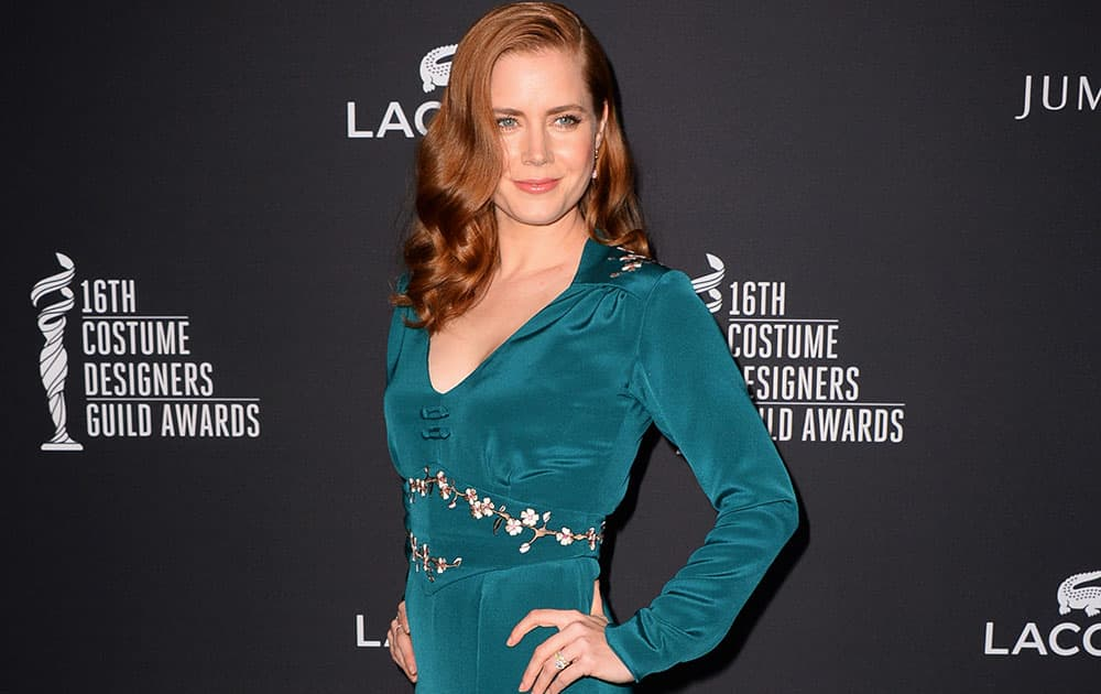 Amy Adams arrives at the 16th Costume Designer Guild Awards, in Beverly Hills, Calif.